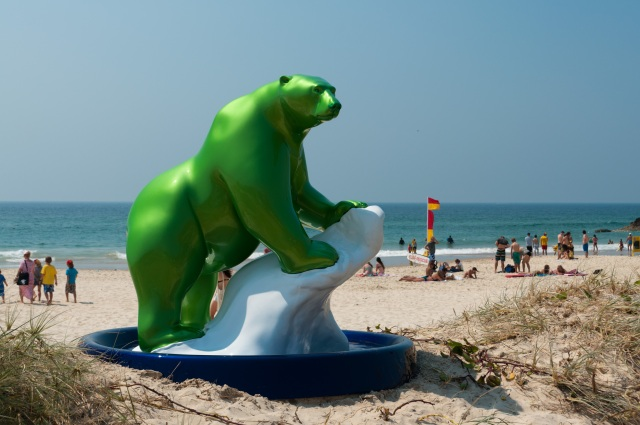 Green Polar Bear sculpture on the beach