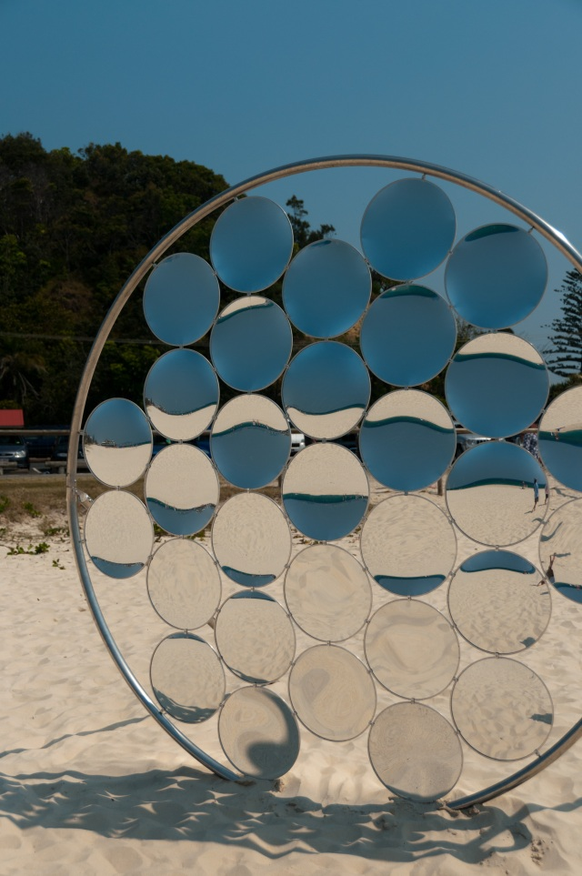 Reflective sculpture at Swell Sculpture Festival